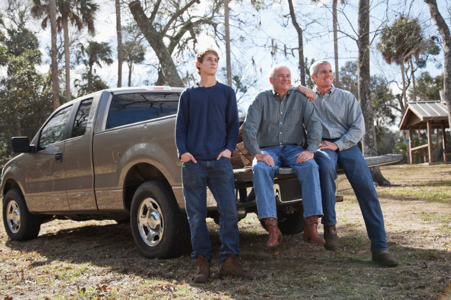 image of family sitting on truck in florida